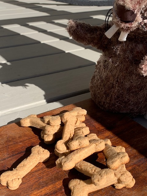 Dog bones with a beaver play toy